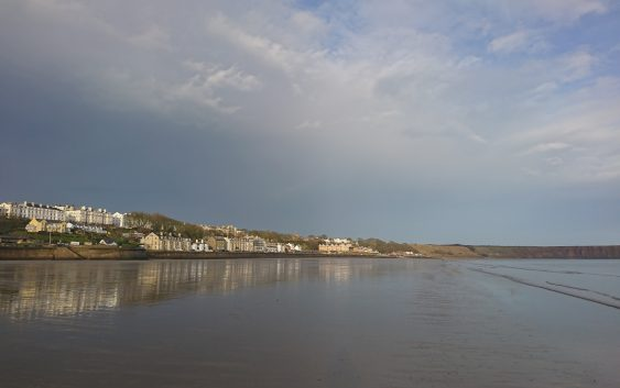 Filey Beach at Low Tide looking from beach towards the town and Brigg.