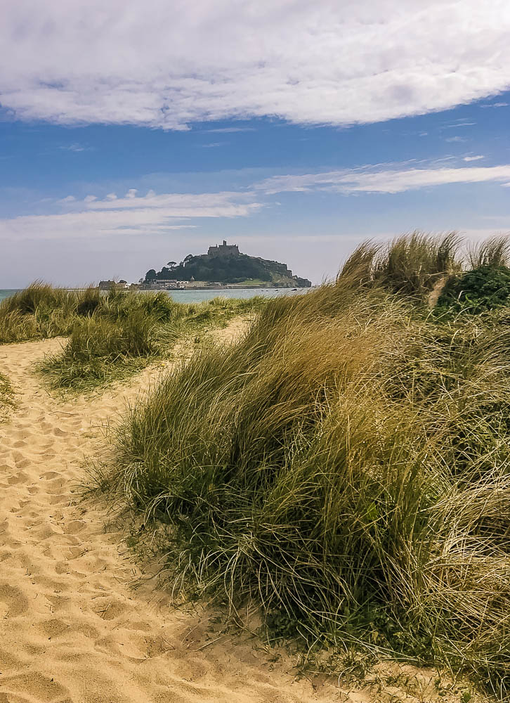 View of St Michael's Mount from the sand dunes on Marazion beach.
