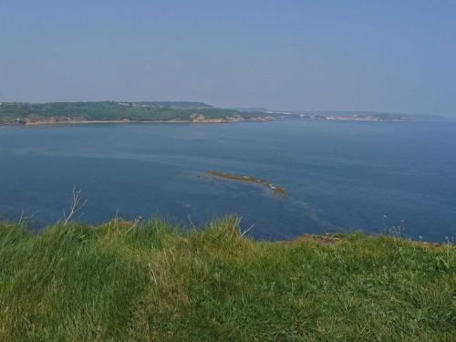 Cayton Bay at high tide viewed from the top of the cliffs at the southern end of the bay