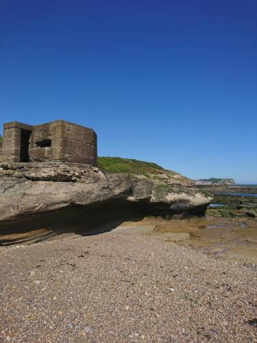 The beach and World War Two pillbox at Cornelian Bay looking towards Scarborough.