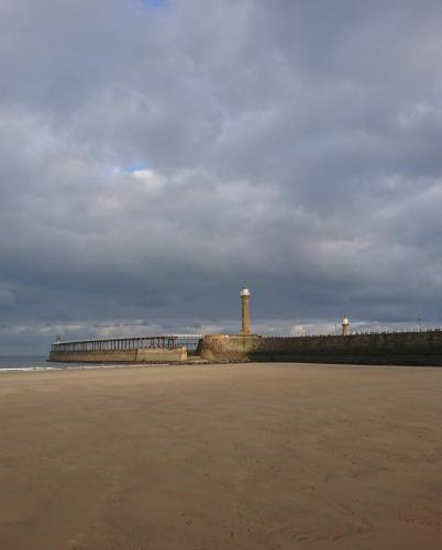 Beach level view of Whitby West Pier.